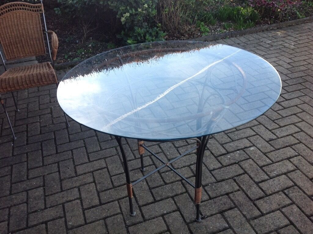 """Circular glass table and 2 chairsin Bramhope, West YorkshireGumtree - Lovely table and 2 chairs purchased from Harvey Nichols. Table 29"""" high x 39"""" wide. Glass top with metal base"""