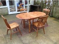 Oval, extendable pine table and four chairs