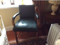 Vintage green leather chair with oak bentwood arms