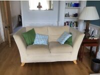 Two comfy cream sofas for sale in good condition.