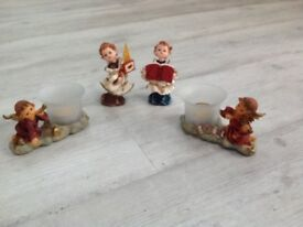 Choir boy figurines and cherub candleholders