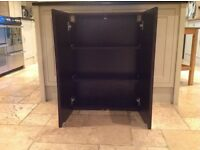 Dark solid wood bathroom cabinet with shelves and mirrored doors