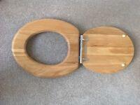 Brand new, unused, quality light oak wooden toilet seat