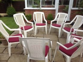 White outdoor/ indoor plastic armchairs stackable with seat covers