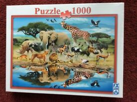 THREE UNOPENED JIGSAWS