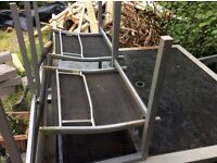 Garden table with 8 chairs in black. In reasonable usable condition, needs cleaning