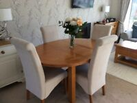 Round extending oak dining table with 4 Next chairs