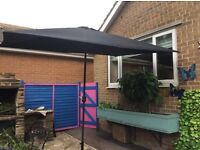 Large black parasol with stand. Excellent condition for sale