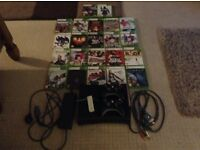 Xbox 360 Perfect Condition. Includes 22 Games And 2 Black Controllers