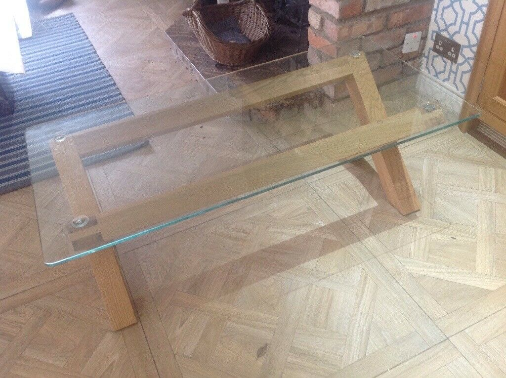 Beautiful Creations solid oak coffee table with heavy glass top.