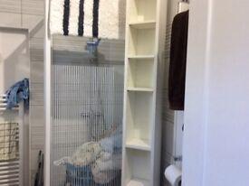 Tall White Ikea Storage Unit.