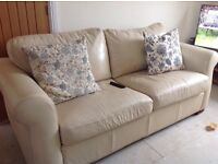 Large cream leather, metal action sofa bed. Small repaired tear to front of one arm.
