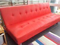 Bright Red Sofa a Bed.