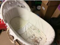 Moses basket and rocking wooden stand.