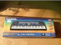 Used Casio CTK-495 electric keyboard with instructions, book and adapter