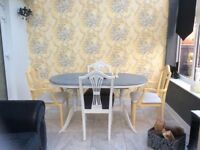 Shabby Chic Grey and White Dining Table with two white chairs and two mustard colour carvers
