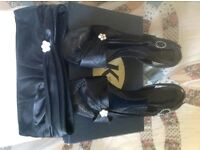 Woman's Black heeled evening shoes with matching bag boxed.vgc