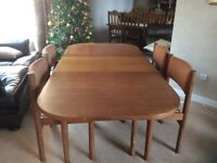 Teak extending dining table and four chairs