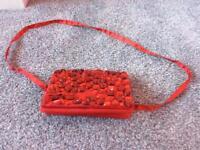 Girls red monsoon bag