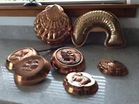 Selection of copper moulds and three French copper pans