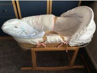 Moses basket with rocking stand.Excellent condition with 2 quilts