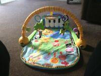 Fisher price baby piano kick mat.