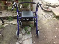4 wheeled walking frame with seat and storage