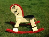 Brightly coloured wooden rocking horse