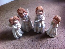 Four Cute little Carol Singing Angels
