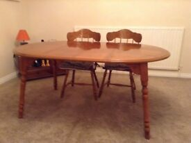 Extendable dining table and 6 matching chairs