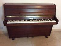 Zender upright piano very little use