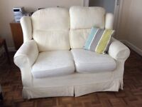 Cream 2 seater sofa with removable, washable covers. Very comfortable. Good used condition.