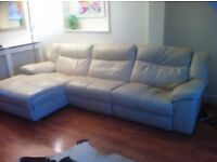 Cream leather sofa, 2 electric recliners, one chaise to form corner suite.
