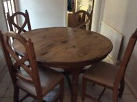Solid pine dining table and 4 chairs £40