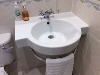 White Free Standing Wash hand Basin with Integrated Towel Rail.