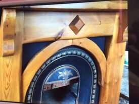 Fireplace surround with cast iron horse shoe inset
