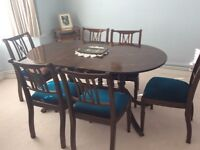 Dining table seats 6, or 8 when pulled out. In perfect condition. And matching sideboard.