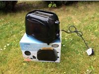 Two slice toaster brand new. Colour black