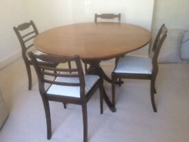 Reproduction mahogany extending table and four chairs