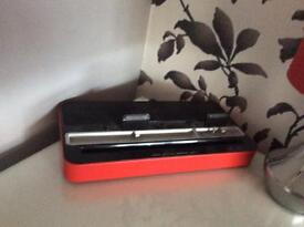 Red iPod/ phone charger/player