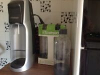 Soda stream and bottles with gas