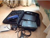 Selection of wireless routers and a Targus Laptop bag.