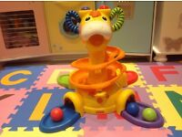 Fisher Price Sit to Stand Giraffe with musical sounds and helta skelta ball run