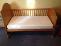 Mama's and Papa's top quality traditional wooden cot. Converts to great toddler bed