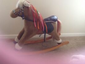 Mamas and Papas large rocking horse with saddle and stirrups