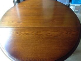 Oak drop leaf table dating from 1920 - 1930s