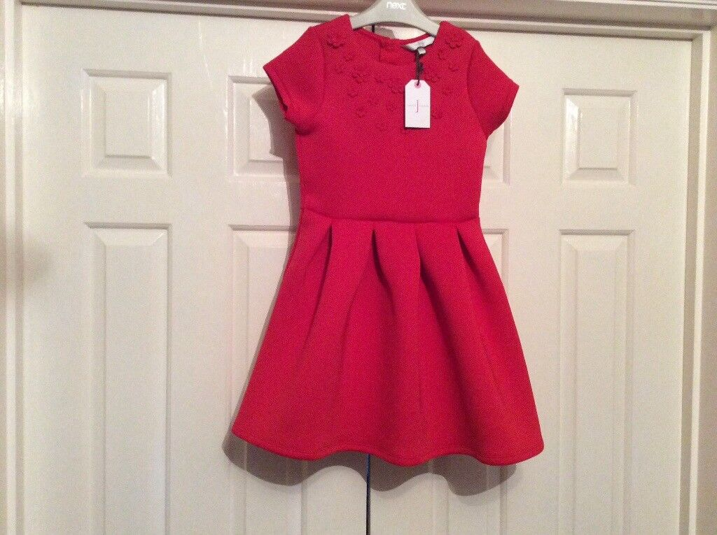 Red party dress to fit age 7 8 brand new with labels in dover