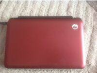 HO mini Notebook in red. Used about twice. Complete with documentation and Microsoft Office 2010