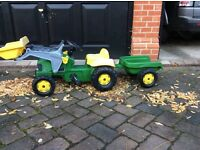 Little boys John Deere Tractor with front loader and trailer. Green and yellow.