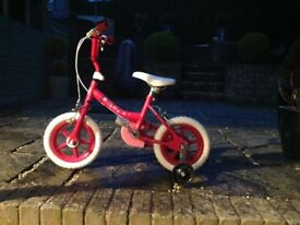 KID ACTIVE girls pink bike with stabilisers. Handle bar height 70cms
